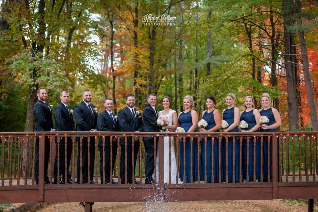 Wedding party photo on our 75 foot photo bridge. Outside wedding ceremony with fall foliage.
